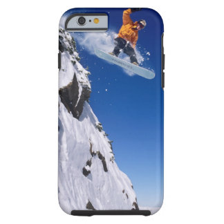 Man on a snowboard jumping off a cornice at tough iPhone 6 case