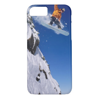 Man on a snowboard jumping off a cornice iPhone 7 case
