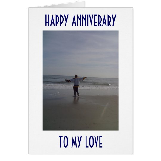MAN ON BEACH DECLARES HIS LOVE ON ANNIVERSARY CARD