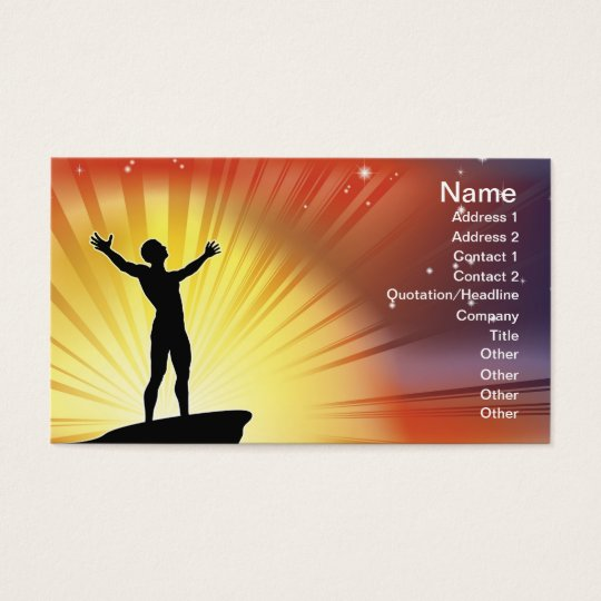 Man on cliff top with arms raised business card