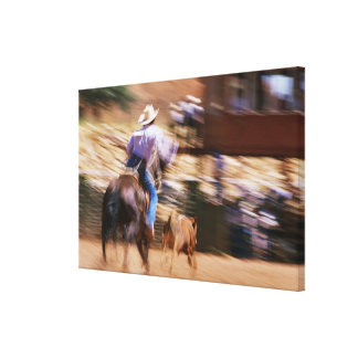 Man on horseback roping calf canvas print