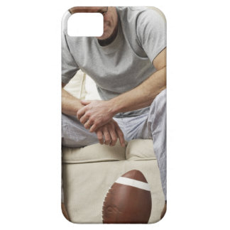 Man on Sofa with Football Case For The iPhone 5
