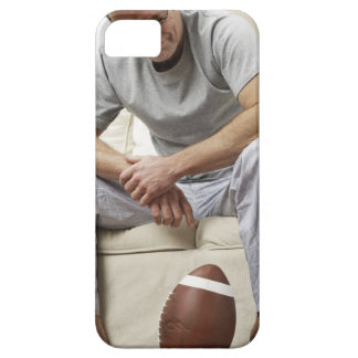 Man on Sofa with Football iPhone 5 Cases