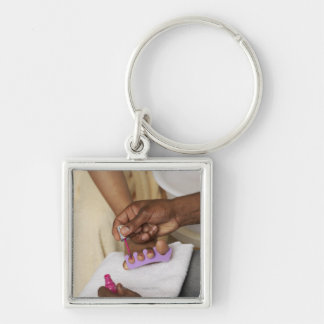Man Painting Woman's Toes Silver-Colored Square Key Ring
