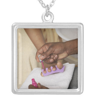 Man Painting Woman's Toes Silver Plated Necklace