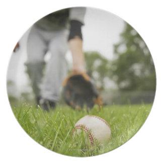 Man playing baseball plate