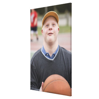 Man playing basketball stretched canvas print