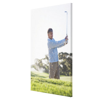 Man playing golf in sand trap canvas print