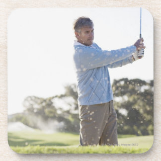 Man playing golf in sand trap coaster