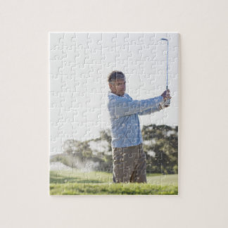 Man playing golf in sand trap jigsaw puzzle