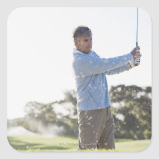 Man playing golf in sand trap square stickers