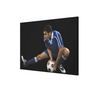 Man playing soccer canvas print
