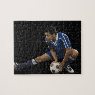 Man playing soccer puzzles