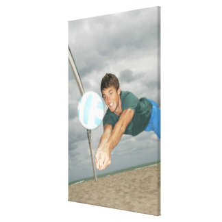 Man playing volleyball on the beach canvas print