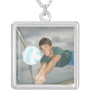 Man playing volleyball on the beach silver plated necklace