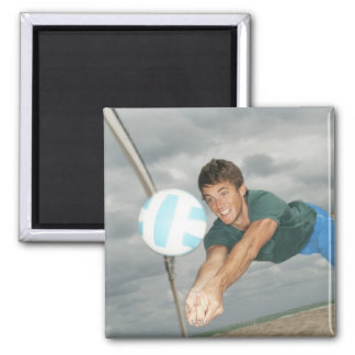 Man playing volleyball on the beach square magnet
