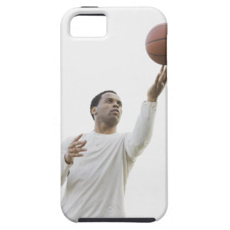 Man playing with basketball, studio shot iPhone 5 cover