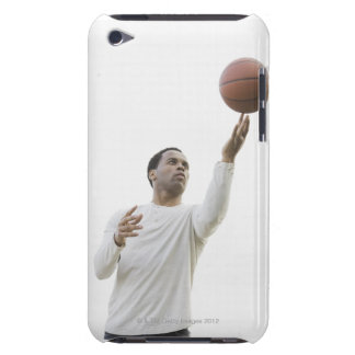 Man playing with basketball, studio shot iPod touch case