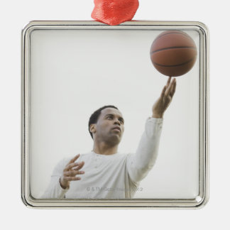Man playing with basketball, studio shot Silver-Colored square decoration