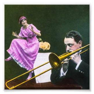 Man plays trombone Flapper  dances on table Photo