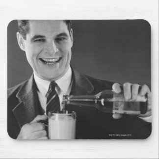Man pouring beer from bottle to pitcher B W Mouse Pad