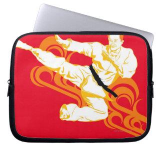 Man practicing martial arts, performing mid air laptop sleeve