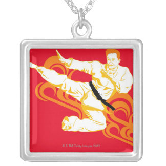 Man practicing martial arts, performing mid air silver plated necklace