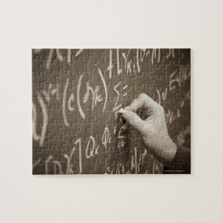 Man printing math equations on a chalkboard puzzle