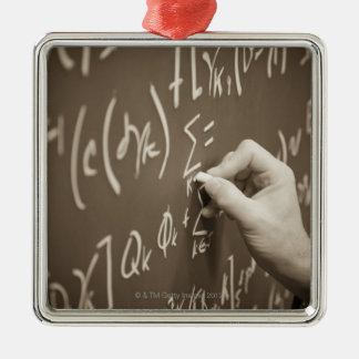 Man printing math equations on a chalkboard Silver-Colored square decoration