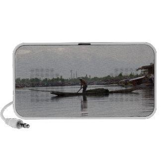 Man pushing a long pole inside Dal lake Portable Speaker