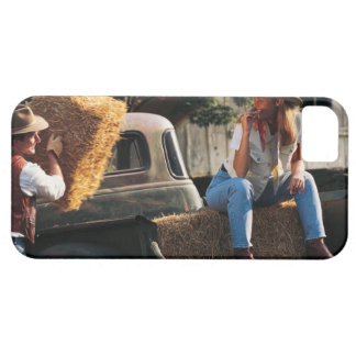 Man putting hay bales in truck with woman case for the iPhone 5