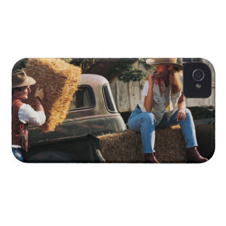 Man putting hay bales in truck with woman iPhone 4 cases