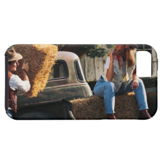 Man putting hay bales in truck with woman iPhone 5 covers