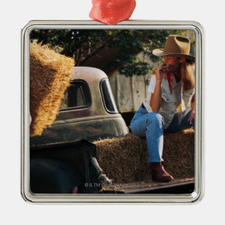 Man putting hay bales in truck with woman Silver-Colored square decoration