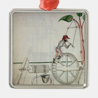 Man Putting into Motion a Wheel-Driven Well Christmas Ornament