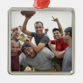Man raising soccer ball celebrating with friends christmas ornament