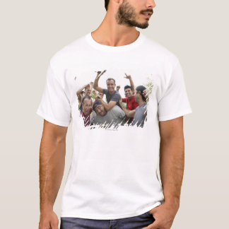 Man raising soccer ball celebrating with friends T-Shirt