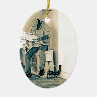 Man Reading Paper Ceramic Oval Decoration