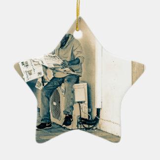 Man Reading Paper Ceramic Star Decoration
