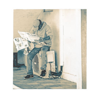 Man Reading Paper Notepads