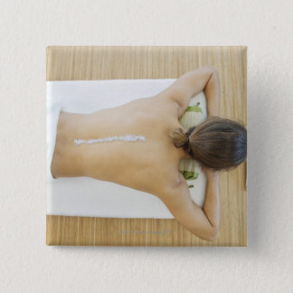 Man receiving spa treatment 15 cm square badge