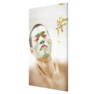 Man Relaxing in a Bathtub with a Facial Mask Canvas Print