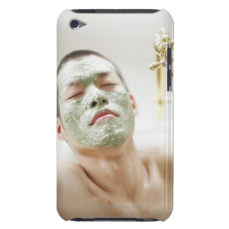 Man Relaxing in a Bathtub with a Facial Mask iPod Touch Cases