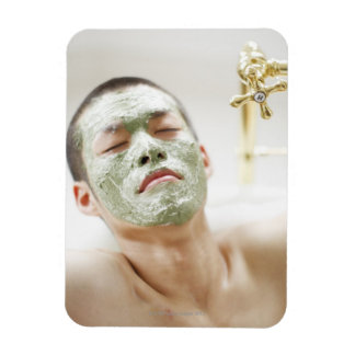 Man Relaxing in a Bathtub with a Facial Mask Magnet