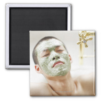 Man Relaxing in a Bathtub with a Facial Mask Square Magnet