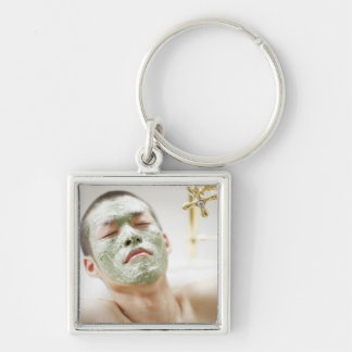 Man Relaxing in a Bathtub with a Facial Mask Silver-Colored Square Key Ring