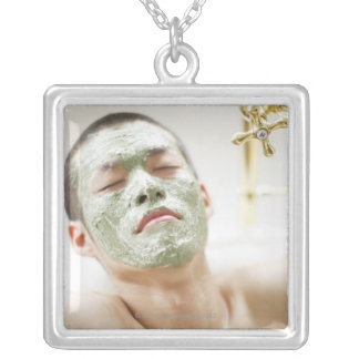 Man Relaxing in a Bathtub with a Facial Mask Silver Plated Necklace