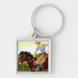 Man riding bucking bronco, side view key ring