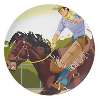 Man riding bucking bronco, side view plate