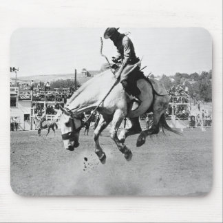 Man riding bucking horse in rodeo mouse mat